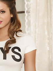 Keisha Grey caresses her breasts wearing sexy clothes